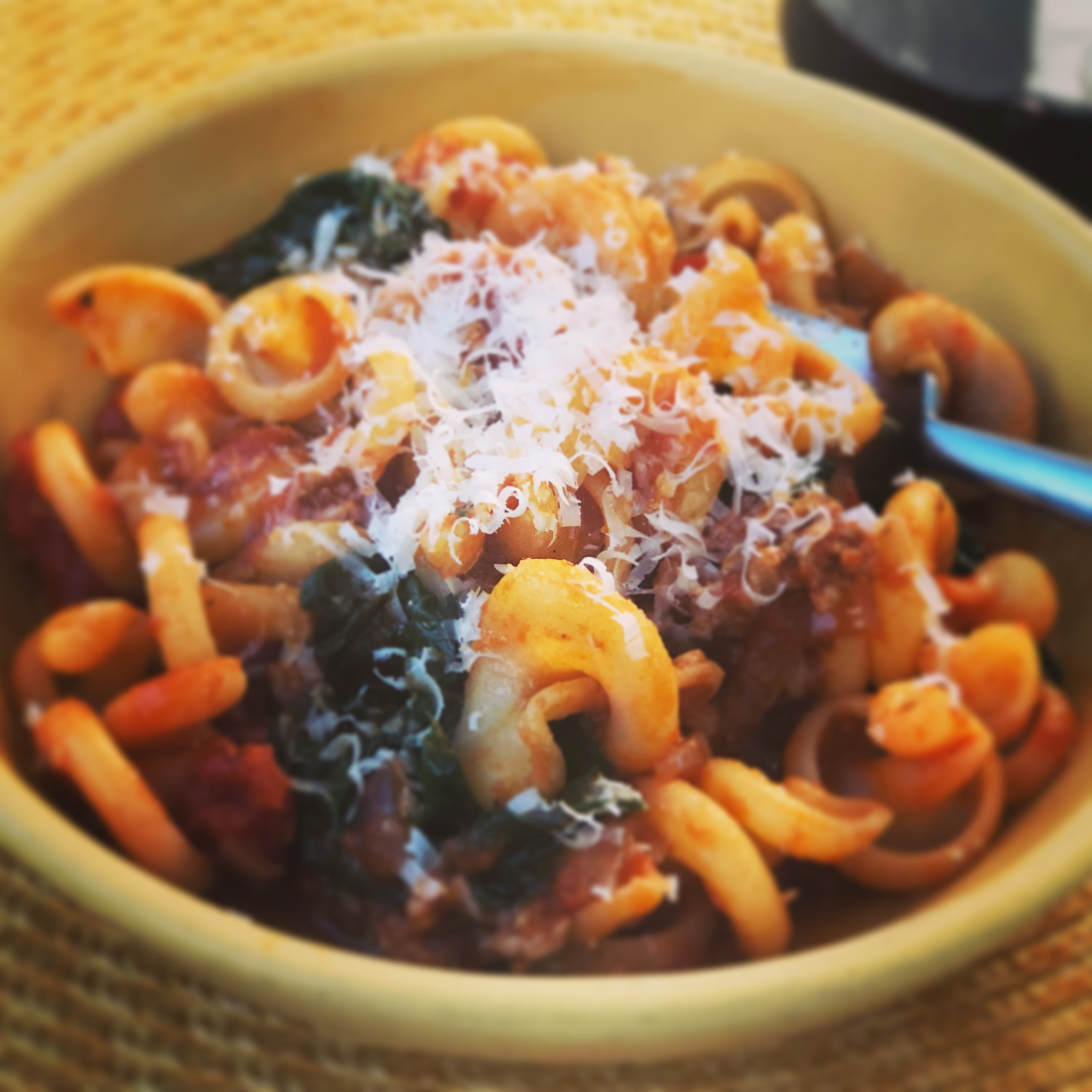 Pantry Pasta with Rao's Arrabbiata, sausage, onion and greens