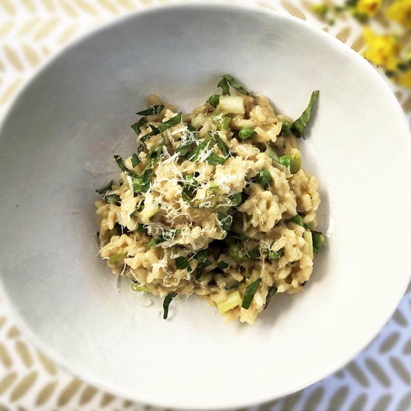 Bowl of Lemon Risotto with Scallions, English Peas, Basil and Parmesan