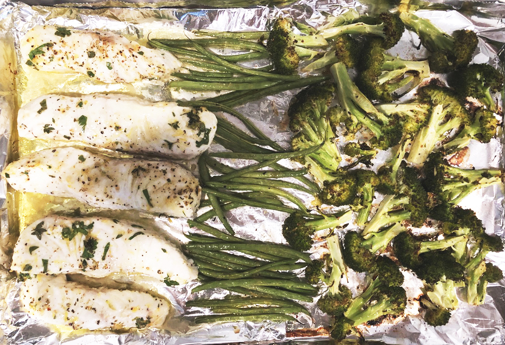 Halibut and vegetables on roasting pan