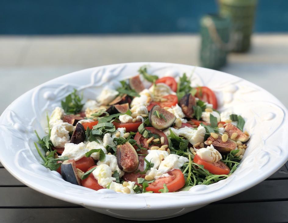 Tomato, Mozzarella and Fig Salad on a bed of arugula