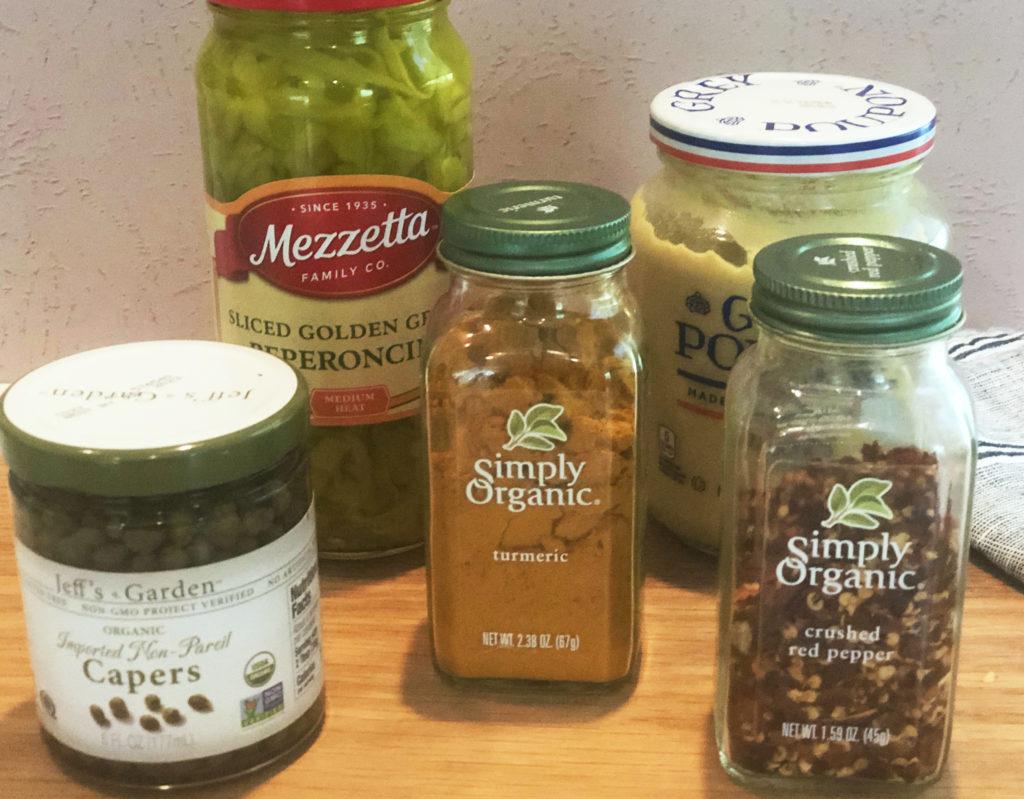 Dressing ingredients: Peperoncini, Dijon mustard, red pepper flakes, turmeric, capers