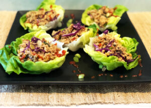 Asian Chicken Lettuce Wraps on a black serving plate